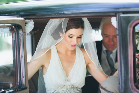 Beautiful wedding makeup with veil and updo