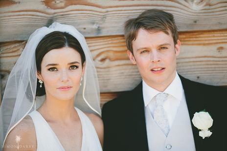 Classic wedding makeup with subtly lined eyes and blush toned lips
