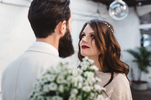 Bride with bold red lip and tousled hair